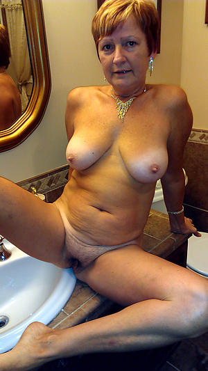 mature simple women posing unfurnished