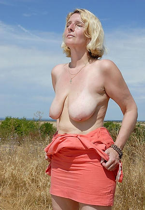 older blonde column posing barren