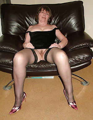 erotic granny in stockings posing bared