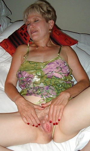 sexy older woman masturbates